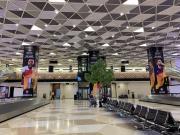 阿塞拜疆巴库机场,过了海关一出来就是各种欧联杯决...
